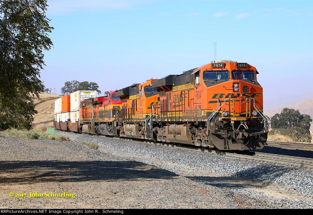 BNSF 7614 (ES44DC) Holds on the main for a down hill unit BNSF grain train. Powering this stack train is a BNSF ES44DC-BNSF Tier4 Gevo-KSCM AC4400CW and a BNSF C44-9W. Bealville, CA. 11/15/2017