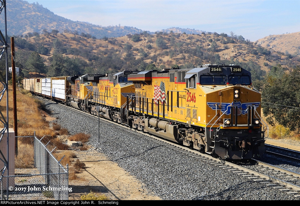 UP ES44AC 2546 an AC4400CW 6273 and an SD70ACe 8576 lead this east bound manifest at Woodford, CA. Rear DPU's are UP Tier 4 Gevo 2721 and another UP ES44AC 7809. 11/14/2017