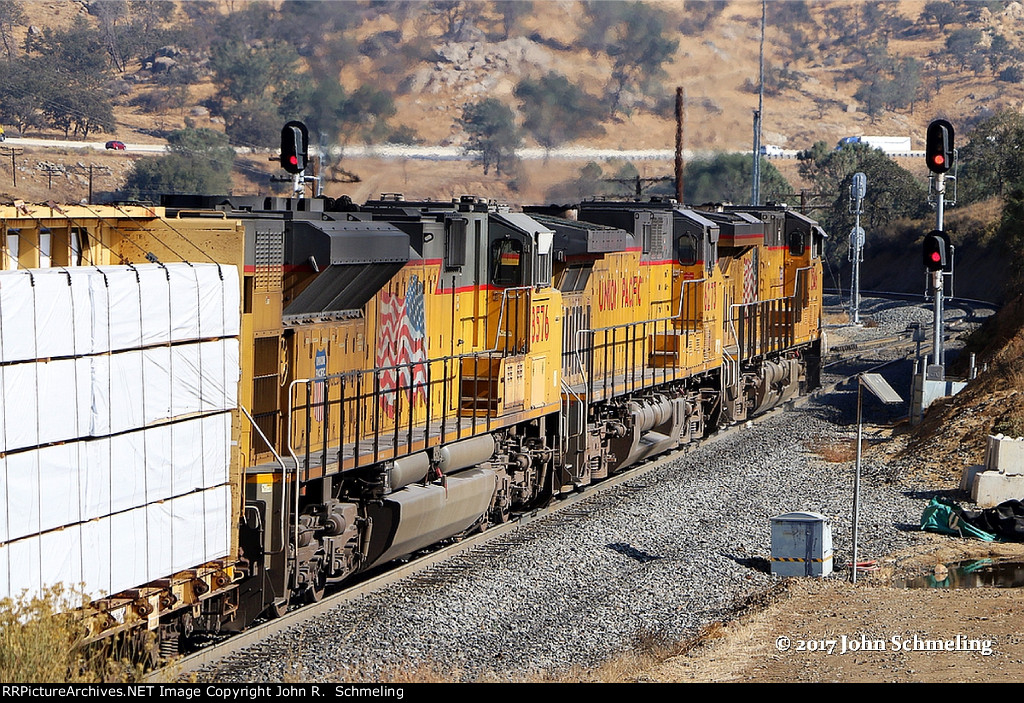 UP  ES44AC 2546 along with an AC4400CW and an SD70ACe split the signals at the east end of Woodford, in a few minutes this train will loop over it self at the Tehachapi loop.  11/14/2017