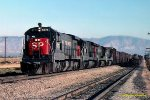 SP #8775 leading a four unit lash up of U33C's pulls out of Mojave CA. 7/20/1978. Photo's date approximate