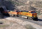 BNSF 6818 (ES44C4) with a westbound stack train exits tunnel one between Bealville and Caliente . 12/22/2017