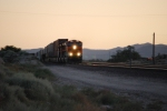 BNSF 7278 fly's around the curve as the engineer starts to apply the brakes and using Dynamic Braking to slow this Baby down for the crew swap at BNSF Barstow, Ca on this Very Hot Desert Sunset Evening Photo.