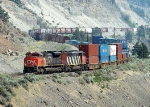 CN 8012 and 5541 Head a mixed freight south through the Fraser Canyon at MP 89.5 of CN's Ashcroft Sub (Morris)
