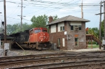 A southbound CN freight on the former EJ & E is about to bang the diamonds at JB tower in West Chicago.