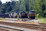 GP30  Road Slug CSX 2225 and a slew of motors bask in the midday heat