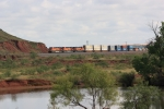 BNSF 7889 passing a small pond
