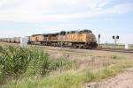 Coal train splitting the triple track signals