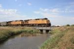 Eastbound coal over a small bridge