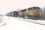 Eastbound manifest rolls through flurries