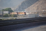 BNSF 7904 has made it into the bottom of Sullivan's Curve on Main # 1 with the I-15 Freeway in the background.