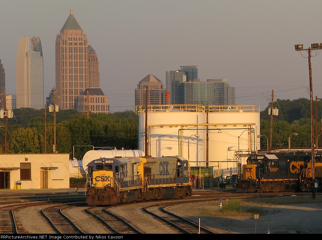 A pair of now retired B30-7's resting under the Atlanta skyline
