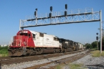 CEFX 6016, still in SOO colors, leads train 119 under the signals at CP Wells