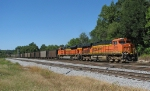 BNSF 5902 leads a loaded Scherer train past Parrot Ave.