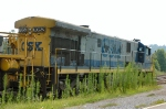 CSX 7052 waits in the weeds with MOW equipment