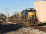 With 8017 pouring the sand on the rails, Q334-10 claws its way east with 134 cars