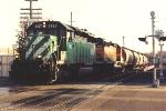 Grain train rolls through crossing