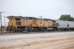 Union Pacific C44-9W 6660 and 7002 shove grain westward