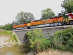 The two BNSF ES44C4's lead the trio of test units on GE's test track over a bridge