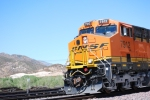 BNSF 7912 close up shot of the cab as she rolls down the Cajon Pass grade with Sullivan's Curve as the background.