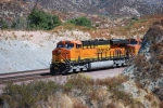 BNSF 7912 and BNSF 5190 poke their noses from aound the curve as they continiue south/west with a loaded Vehicle Train towards San Bernardino, CA.