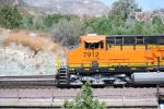 BNSF 7912's Conductor waves to me as they proceed south on their journey to San Bernardino, Ca with a loaded Vehicle Train.