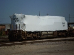 Shrink wrapped locomotive at 8th Street