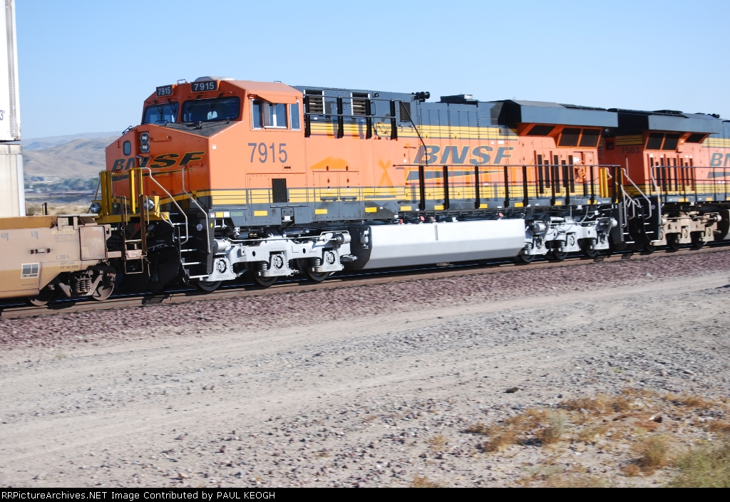 BNSF 7915 rolls past me as she heads east as a # 4 unit on a Z-Train.