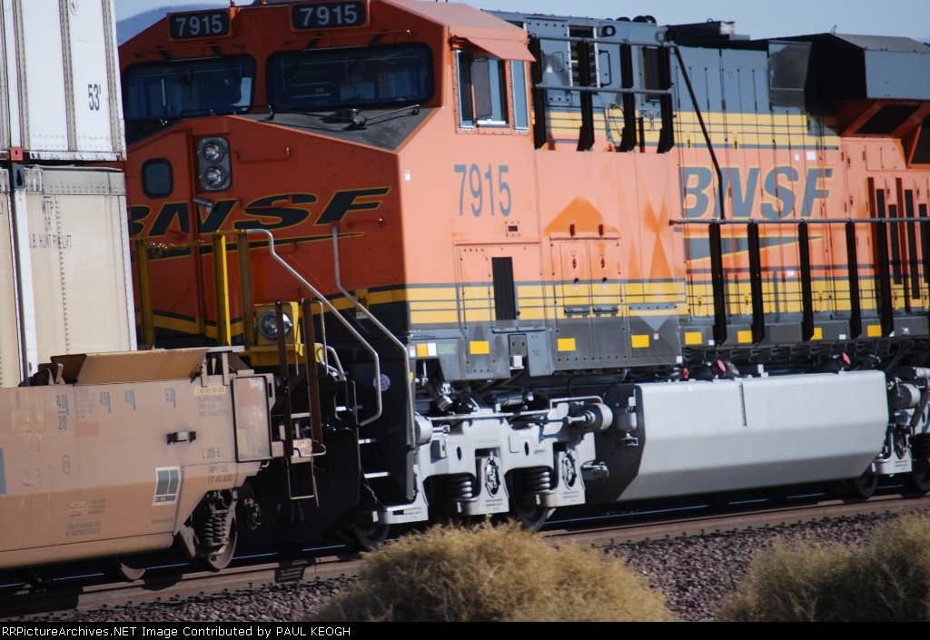 Close up shot of BNSF 7915 as she rolls into the BNSF Barstow yard.
