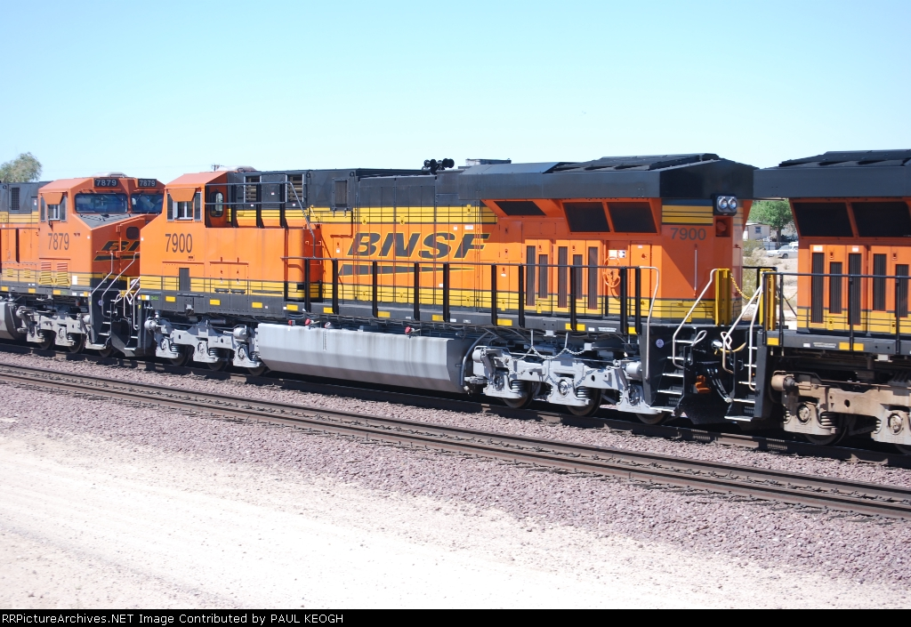 BNSF 7900 passes me by as she rolls west with BNSF 7879 ahead of her.