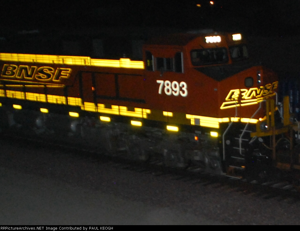 BNSF 7893 close up shot as she rolls east as a rear DPU Unit.