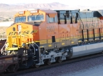 BNSF 7903 rolls eastbound at sunset as a #4 unit on a east Z as she slows down for a crew change at BNSF Barstow yard.