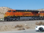 BNSF 7912 leads a vehicle train westbound.