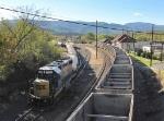 Empty coal train zipping past a yard train