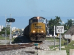 CSXT 4510 leads O721 across Perimeter Rd. and over the new connector track