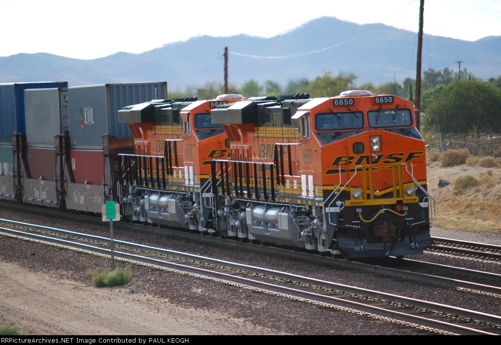 Two Very Brand and Very Clean ES44C4's push the Z CHI-LAC westbound on their First Run West.