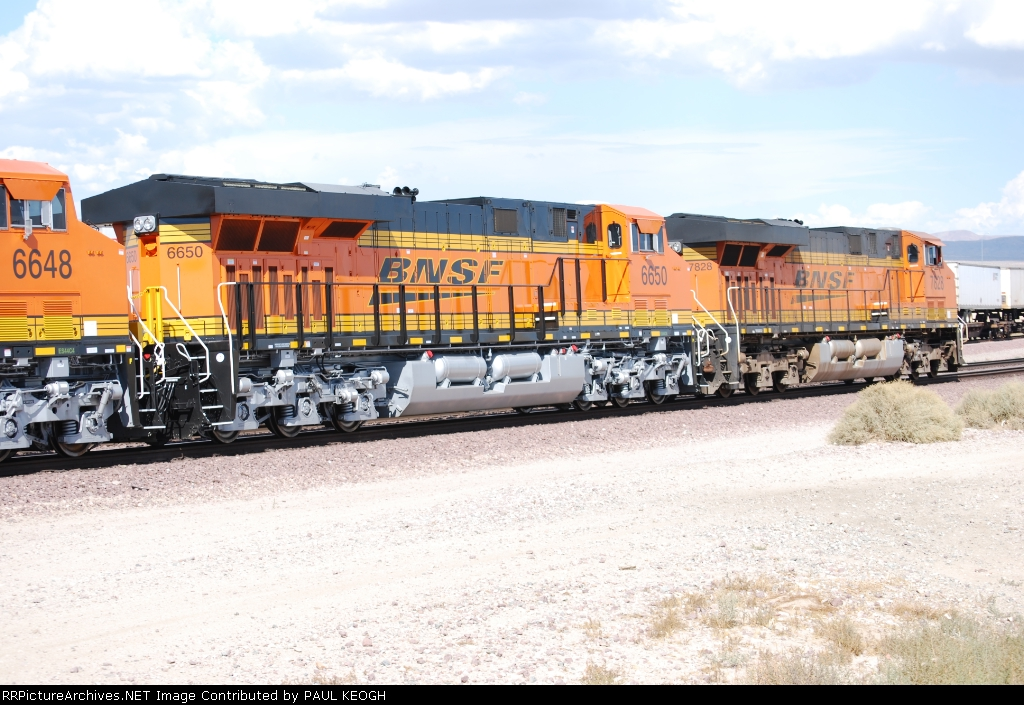 BNSF 7828 leads Two Very Brand New ES44C4's into the Barstow yard (BNSF 6650/BNSF 6648).