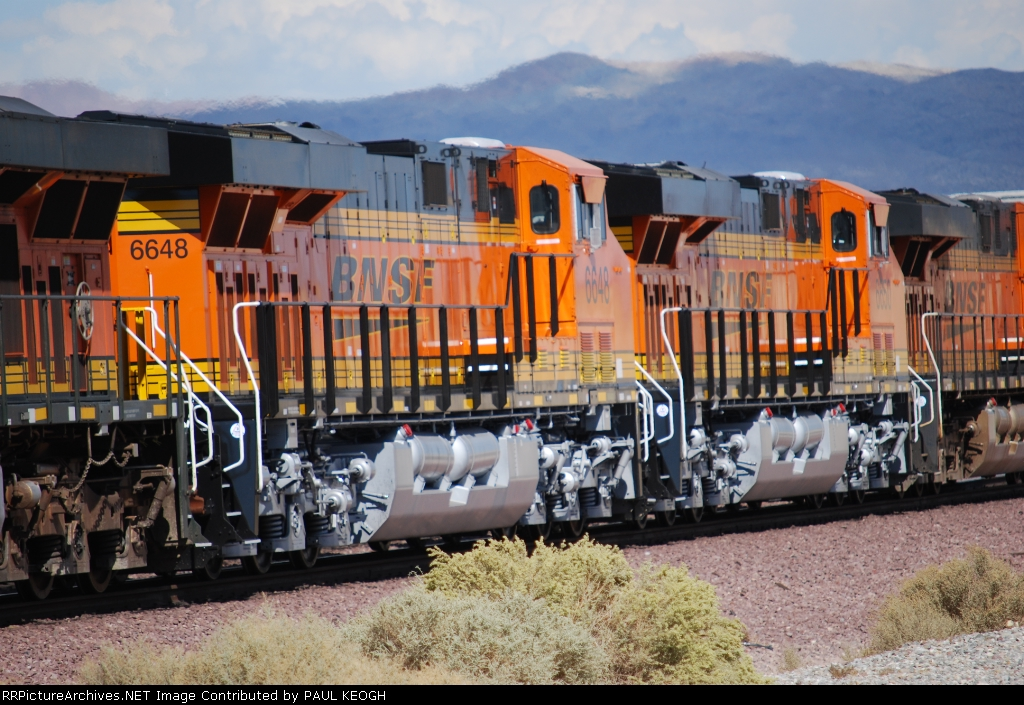 Two Newest ES44C4's I've got pass me by as they head eastbound into the BNSF Barstow yard (BNSF 6648 and BNSF 6650).