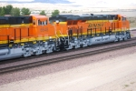 BNSF 6648 and her sister unit BNSF 6650 roll west as rear DPU's on their First Run West.