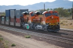 BNSF 6648 and BNSF 6650 roll westbound into the setting sun as they push the Z CHI-LAC on their First Run West.