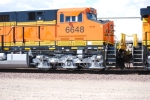 Side shot of the cab of BNSF 6648 and the rear of BNSF 6650 as they make there way towards BNSF Barstow yard for a crew change.