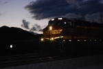 BNSF 7302 at Twilight lights up her reflective BNSF Swoosh logo as she heads westbound.