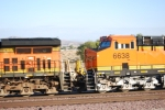 Side shot of the cab of BNSF 6638 as the sun reflects of her BNSF Swoosh logo.