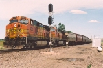 Westbound grain train pulls out of siding