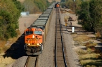 BNSF 6144, GE ES44AC, is westbound with coal empties