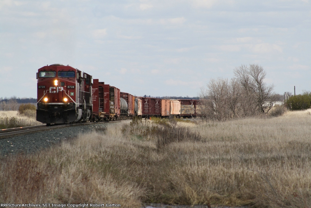 CP 8728 Runs a Manifest Train West