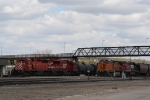 CP Transfer Backs Past a BNSF Grain Train