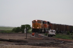 An Eastbound Coal Train Passes a Rail Inspector