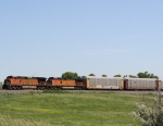 BNSF 4882 on the Point of an Autorack Train Rolls into Town