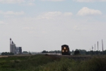 BNSF 4411 Approaches with a Grain Train