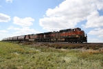Pretty H1 Motors Lead an Eastbound Grain Train on the Glasgow Subdivision